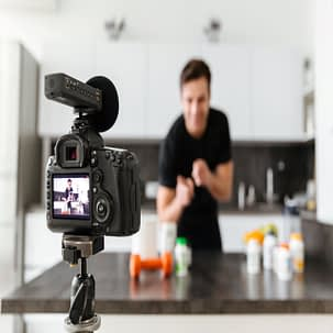 happy-young-man-filming-his-video-blog-episode