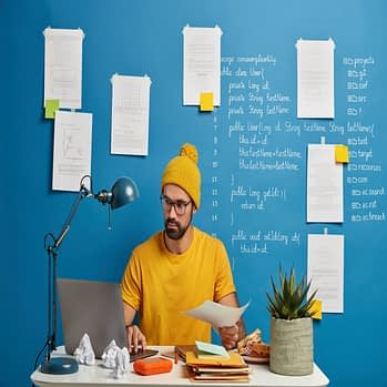 businessman-works-with-papers-involved-working-process-office-thinks-about-plan