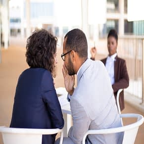 employees-gossiping-about-young-female-colleague