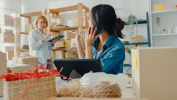 young-asian-businesswoman-wearing-face-mask-using-mobile-phone-receiving-purchase-order-checking-product-stock-work-home-office (1)
