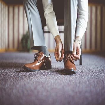 closeup-shot-male-tying-his-shoes-getting-ready-business-meeting