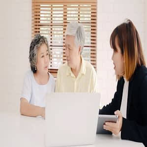 asia-smart-female-agent-offers-health-insurance-elderly-couples-by-document-tablet-laptop