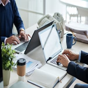 side-view-cropped-unrecognizable-business-people-working-common-desk